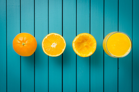 50681661 - fresh oranges and orange juice on wooden table