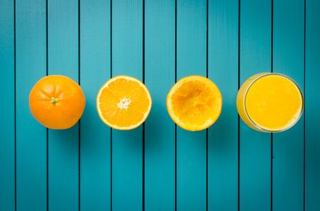 50681661 - fresh oranges and orange juice on wooden table